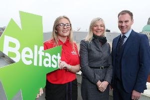 Belfast City Council CEO Suzanne Wylie, centre, with GLL NI regional director Gareth Kirk and Devon Small, GLL