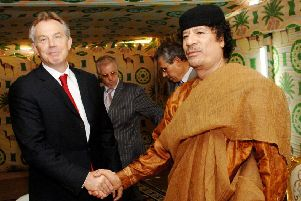 Then prime minister Tony Blair meeting Libyan leader Colonel Muammar Gaddafi at his desert base outside Sirte south of Tripoli in 2007. Gaddafi supplied several tonnes of Semtex explosive to the IRA