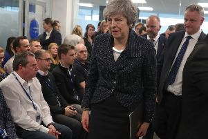 Prime Minister Theresa May arriving to deliver a speech at insurance firm Allstate in Belfast on February 5, 2019