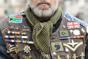 One of the motorcyclists taking part in the Rolling Thunder ride protest in London wearing a jacket adorned in medals and badges. The ride is to support of Soldier F who is facing prosecution over Bloody Sunday. PRESS ASSOCIATION Photo. Picture date: Friday April 12, 2019. Soldier F is to be charged with murdering two people after troops opened fire on civil rights demonstrators in Londonderry in 1972. See PA story ULSTER Sunday. Photo credit should read: Kirsty O'Connor/PA Wire