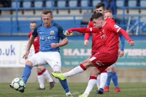 Coleraine's Ben Doherty tries his luck as Glenavon's Sammy Clingan closes him down