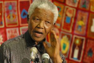 """Former South African president Nelson Mandela at a World AIDS Day function in Bloemfontein, South Africa, in December, 2002. George McNally writes: """"I witnessed the excesses of Apartheid in South Africa and followed the long struggle for political freedom as exemplified by Nelson Mandela's life.""""  (AP Photo/Benny Gool)"""