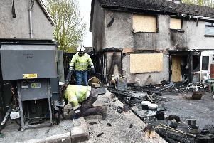 One house was destroyed and another badly damaged in the fire, which also damaged an electricity substation