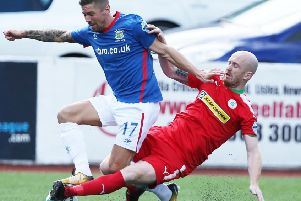 Cliftonville's Ryan Catney (right) in action against Linfield
