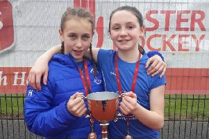 Katie Herron and Rebekah Lennon with the NI club trophy they won with Portadown