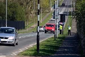 Officers carry out speed checks.