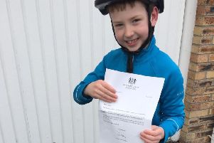 Joshua Bentley, eight, with the reply he received from Downing Street to his letter to the Prime Minister about making cycle helmets mandatory