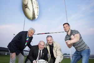 Former British and Irish Lion Willie John McBride and Ulster Rugby's John Cooney join William McKeown, president of Carrick RFC  and Richard Rogers, from the Alpha Programme, to celebrate the funding award.