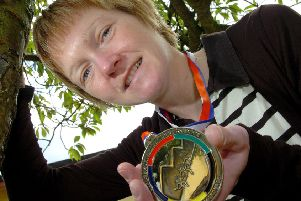 Karen Alexander proudly displays her silver medal after competing at the World Mountain Marathon Championships held in Podrdo in Slovenia