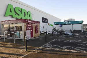 The two ATMs were ripped from a wall at an Asda supermarket in Antrim in February