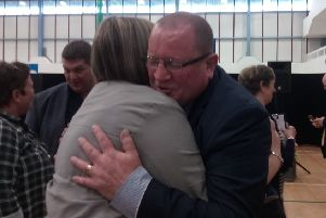 Alliance's Neil Kelly pictured hugging a supporter in the Valley Leisure Centre on 03-05-19, after securing a massive victory in Antrim.
