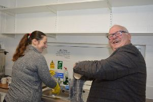 Andrew Hough from the Bucks Masonic Charitable Fund helps out with the washing up during a visit to Buckingham Youth Club