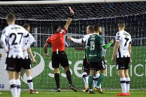 Referee Robert Hennssy showing Patrick Hoban of Dundalk a red card,
