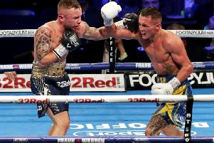Carl Frampton and Josh Warrington (right) in action in Manchester