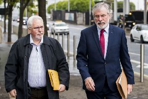 Former Sinn Fein President Gerry Adams (right) with Richard McAuley, arrives at Laganside Court in Belfast to give evidence as the inquest continues into the series of incidents between 9 and 11 August 1971, in which the 1st Battalion, Parachute Regiment killed eleven civilians in Ballymurphy, Belfast. Photo: Liam McBurney/PA Wire