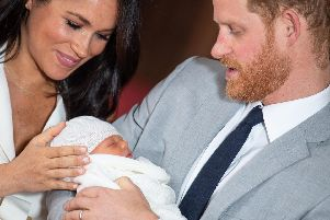 Prince Harry and Meghan Markle with their newborn son, Archie Harrison Mountbatten-Windsor.