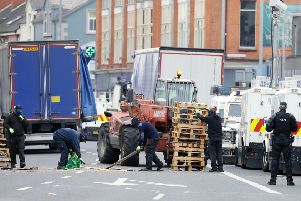 The PSNI oversaw the removal of the Cluan Place bonfire in east Belfast by contractors last summer