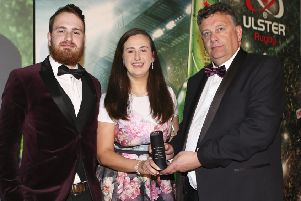 Paddy Elliott and Orla McMahon of Queen's University Rugby receives the Club of the Year Award sponsored by Kukri Sports from Terry Jackson, during the Heineken Ulster Rugby Awards held at the Crowne Plaza Hotel