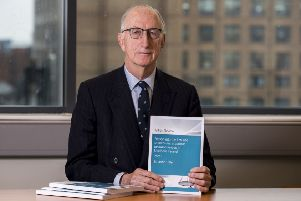 Sir John Gillen holds a copy of the Gillen Review Report into the law and procedures in serious sexual offences in Northern Ireland, in which he has made 16 key recommendations following a review of how the legal system handles complaints of sexual offences. PRESS ASSOCIATION Photo. Picture date: Wednesday May 8, 2019.