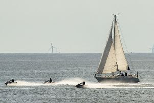 A boat and jet skiers enjoy the hot weather near Bridlington,  as temperatures are set to soar again following a week of bad weather. PRESS ASSOCIATION Photo. Picture date: Sunday May 12, 2019. Photo credit should read: Danny Lawson/PA Wire