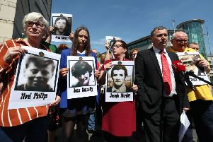 John Teggart (second right), whose father Danny was shot dead in Ballymurphy, speaks to the media outside Belfast Coroner's Court, alongside other bereaved relatives