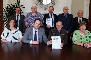 Kenny Donaldson of Innocent Victims United, front row second from left, and Ken Funston, back row centre, of South East Fermanagh Foundation (SEFF), with representatives of various victims' groups presenting a response to the legacy consultation at Stormont House  last September
