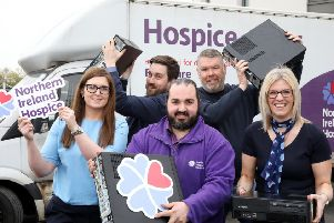 Karen Ferguson, IT manager STM, Jonathan Lamberton, NI Hospice and Angela McKay general manager STM, front row, with Ian Lee STM and Gerry Griffin NI Hospice