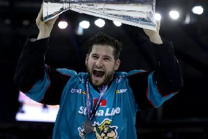 Belfast Giants' Jordan Smotherman pictured with the Elite Ice Hockey League trophy