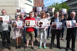 Families of the 6 people who died on the 9th of August 1971, during the first day of the Ballymurphy Massacre hold images of those who died outside Laganside Court in Belfast as the inquest continues into the series of incidents between 9 and 11 August 1971, in which the 1st Battalion, Parachute Regiment killed eleven civilians in Ballymurphy, Belfast