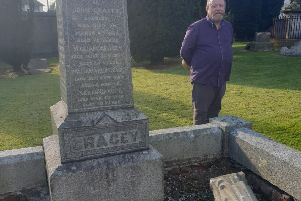 Jim Conway of Friends of Shankill Graveyard beside yet another historic headstone which was vandalised recently