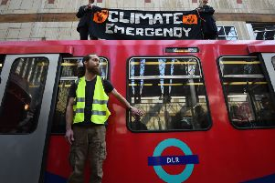 File photo dated 17/04/19 of climate activists Cathy Eastburn, 51 from Lambeth, south London and Luke Watson, 29, of Manuden, Essex,(both top) and Mark Ovland, 35 of Somerton, Somerset, glued to a Docklands Light Railway train at Canary Wharf station