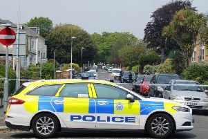 Officers on the scene in Gratwicke Road
