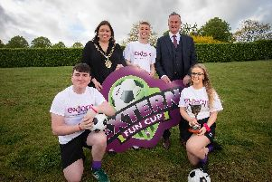 Northern Ireland football manager Michael ONeill and outgoing Belfast Lord Mayor Deirdre Hargey with Extern service users Declan Gill, Gerard McLarnon and Colleen McStravick.