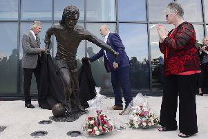 George Best statue unveiled in Belfast, Northern Ireland. The life sized statue sits outside the Olympia Leisure Centre - just yards away from Windsor Park where Best played many games for Northern Ireland. Pictured at the unveiling Pat Jennings former Northern Irish footballer, Barbara McNarry George Best's sister and football fan Robert Kennedy unveil the statue.