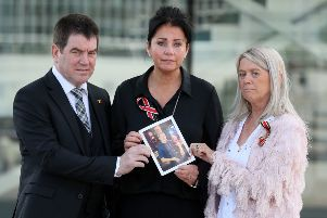 John Conway with his sisters Christina McLaughlin (centre) and Patricia Kelly, hold a photograph of their brother Seamus Conway who died last year at 45 from liver cancer after contracting hepatitis C from contaminated blood product