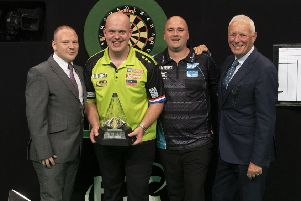 Rob Cross (second-right) and Michael van Gerwen (second-left) at the presentation ceremony after the final. Picture courtesy Lawrence Lustig/PDC