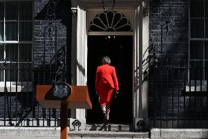 Prime Minister, Theresa May, enters 10 Downing Street after confirming the date she will step down. (Photo: P.A. Wire)