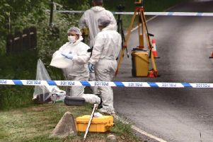 Forensic teams working at the site