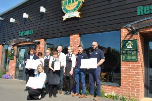 From left -: Eve Bowler and John Maddison from Sleaford Dementia Support, Adrian and Rachel Tweedale co-directors at The Elite Fish & Chip Company along with staff members Tracey Donoghue and Ella Good, Daniel Cooper and Chris Nisbet from the RNLI and Lucy Slonecki from the RAF Association with the ?32,128.92 donation. EMN-190521-090320001