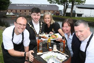 Mayor of Causeway Coast and Glens Borough Council Councillor Sean Bateson is joined by celebrity chef Ian Orr from Browns Bonds Hill Group, Sharon Scott from Taste Causeway, Joanna Morrow from Bushmills Distillery and Gary Stewart from Tartine Restaurant to mark the return of Bushmills Salmon and Whiskey Festival this weekend