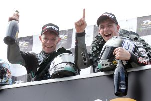 Ben and Tom Birchall celebrate their sixth Isle of Man TT Sidecar victory in succession after they won Monday's opening race.