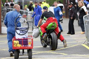 Machines are wheeled away from Parc Ferme after racing on Wednesday was cancelled due to poor weather.