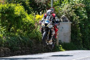 Supersport TT race winner Peter Hickman flies over Ballacrye on the Trooper Beer Smiths Racing Triumph.