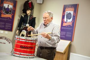 Veteran pipe band drummer Wilby Hanna (Upper Crossgare LOL 1608) playing one of the innovative drums he designed and built in 1981