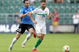 Estonia's Sergei Zenjov with Northern Ireland's Stuart Dallas