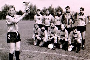 The Helpringham football team with their cup in 1994. EMN-190606-152711001