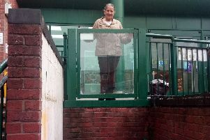 Banbury Town Councillor Surinder Dhesi and the Castle Quay lift which has now been fixed NNL-190618-110803001