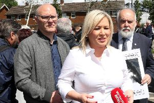 Michelle O'Neill, centre, and other Sinn Fein politicians attended the Time for Truth march in Belfast, above. She then attended the commemoration of an IRA man in Crossmaglen