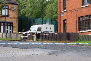 Police have launched an investigation after two people were found dead at house in West Belfast . 'The pair, understood to be a man and a woman, were discovered at a property in the Woodside Drive area of Poleglass on Thursday