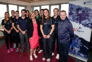 Department for Communities Permanent Secretary Tracy Meharg pictured with the Northern Ireland Netball Team, Head Coach Dan Ryan and Geoff Wilson, Chair of Netball NI.